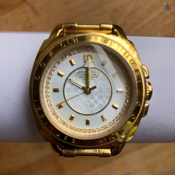 Gold and diamond accent coach watch